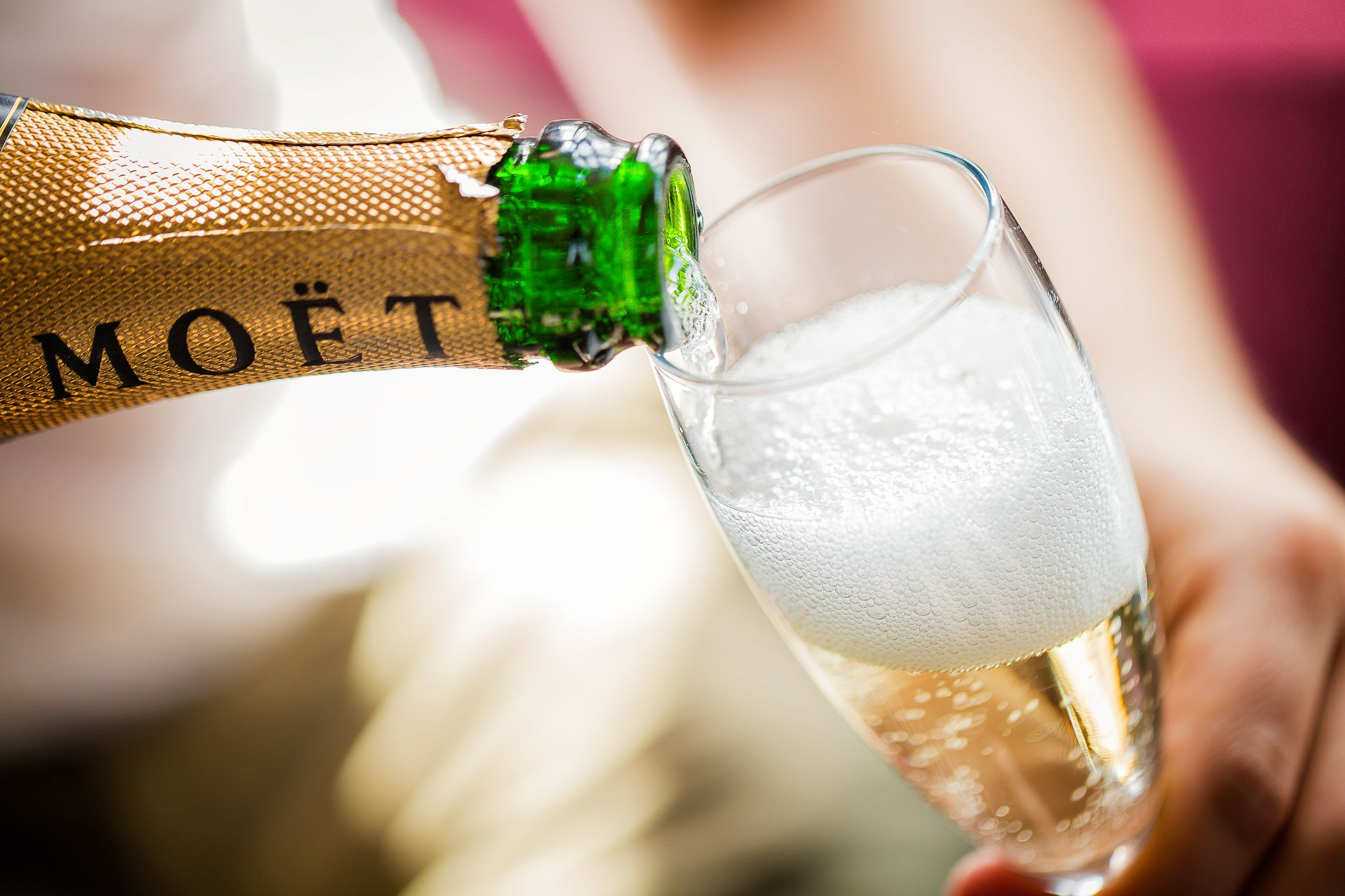 Moet champagne being poured into a champagne glass