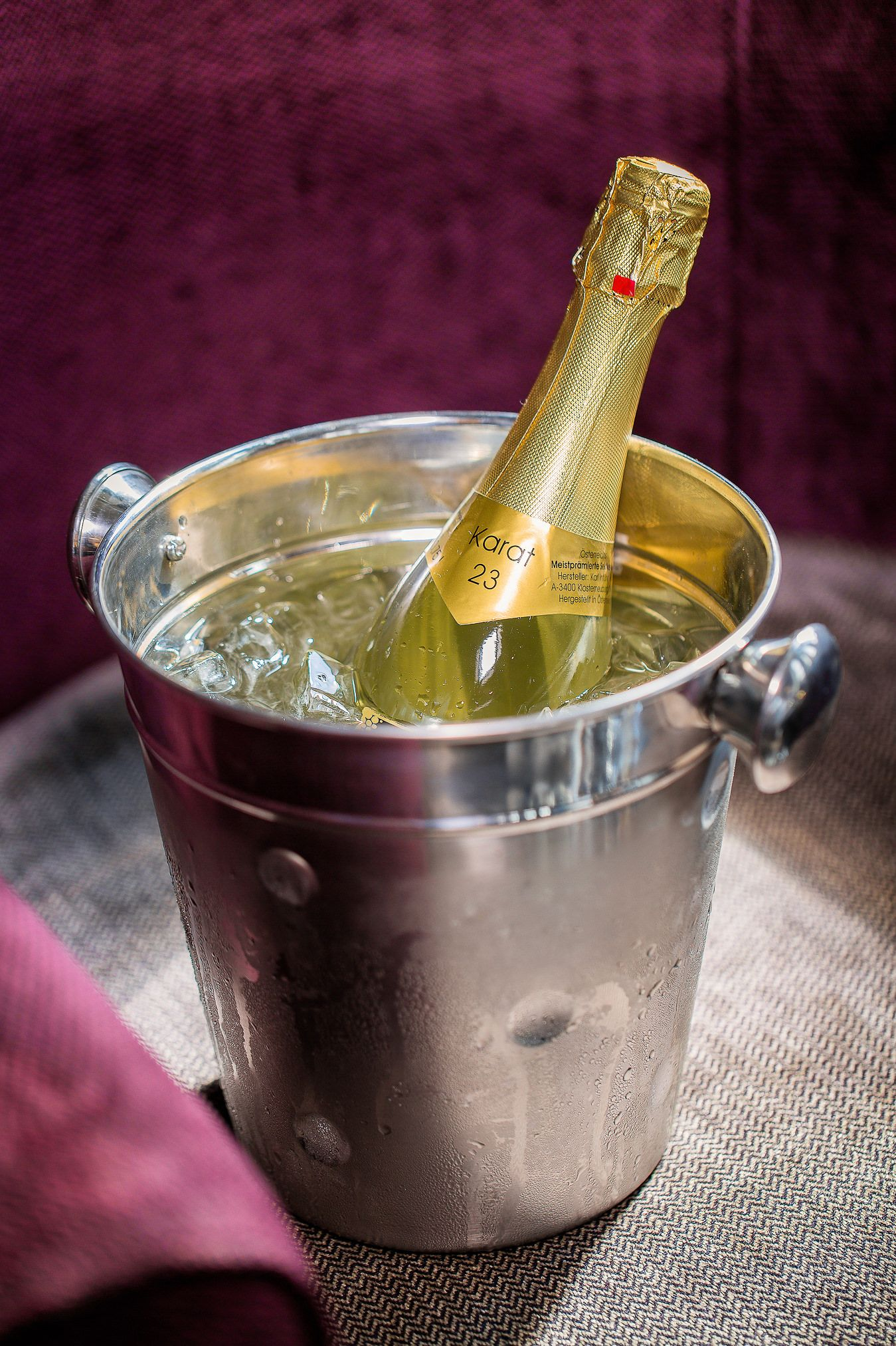 Champagne resting in a bucket of ice