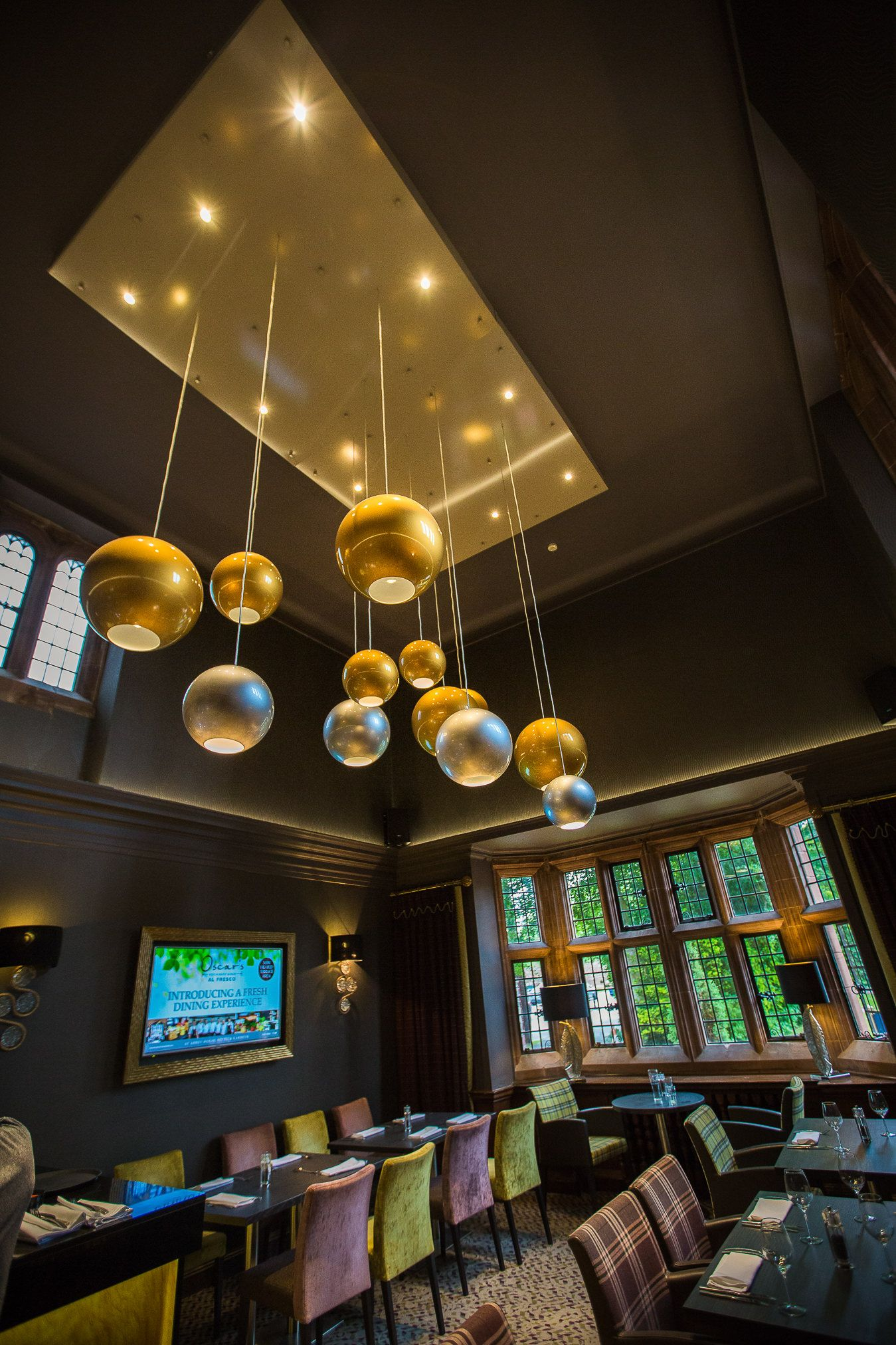 Bauble light decoration feature hanging from the restaurant ceiling at Abbey House in Cumbria