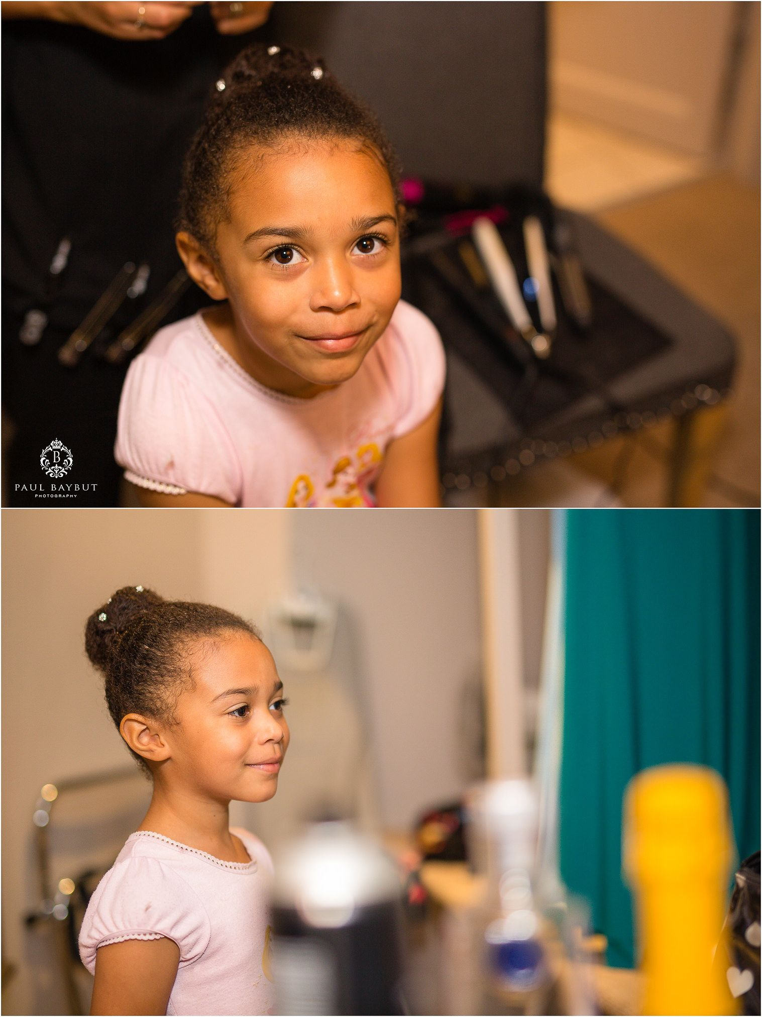 Cute little girl bridesmaid posing indoors for portrait during bridal prep