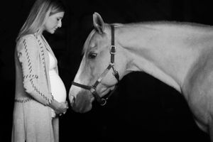 Beautiful maternity portrait of a woman and her horse captured by plymouth ma photographer Heidi Harting