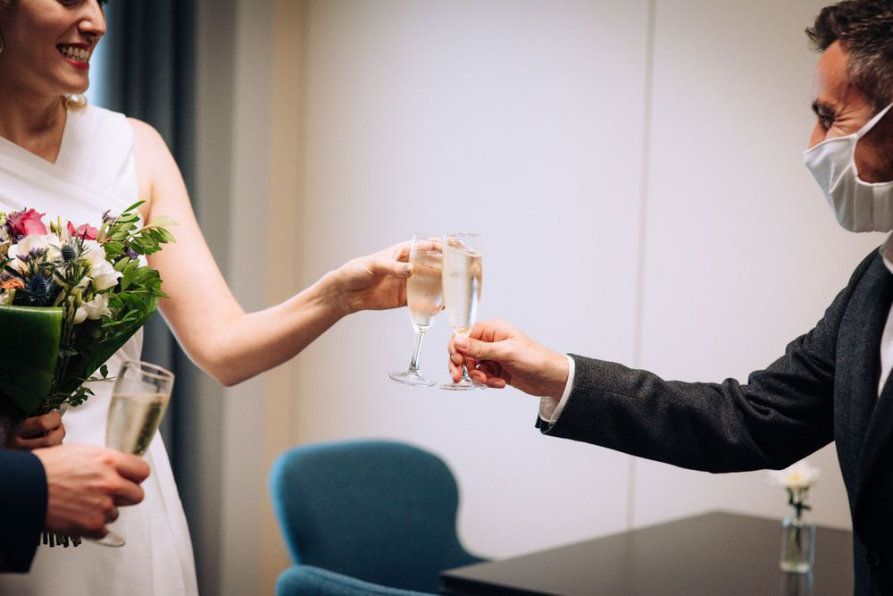 Pukrup Hall wedding by Zara Davis Photography, Gloucestershire cheers with clinking glasses