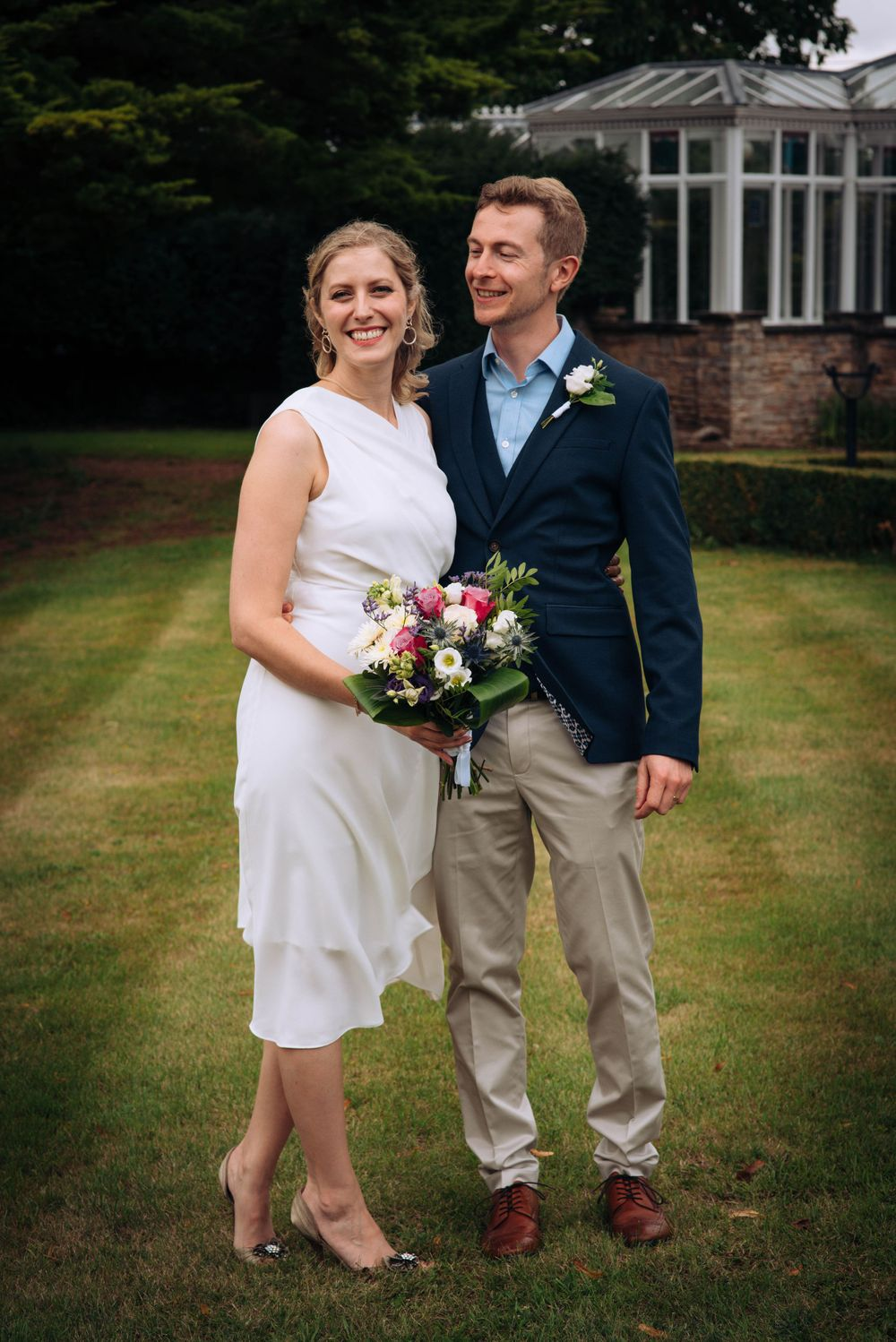 Pukrup Hall wedding by Zara Davis Photography, Gloucestershire outside bride and groom