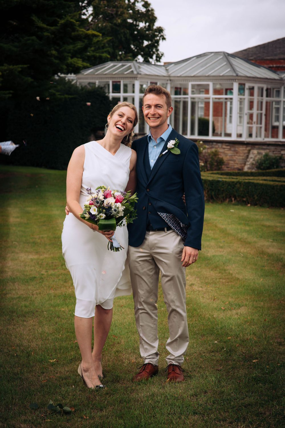 Pukrup Hall wedding by Zara Davis Photography, Gloucestershire posing bride and groom outside