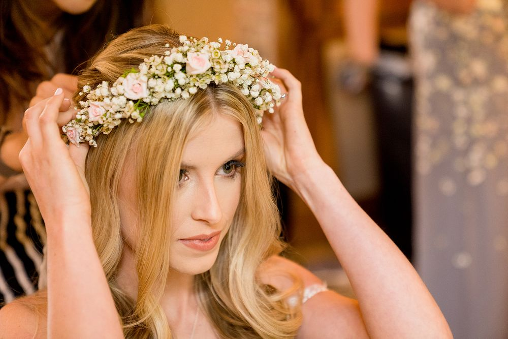 brie putting on pink rose flower crown