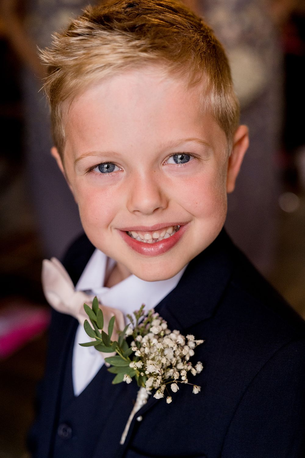 ring bearer with pink bow tie