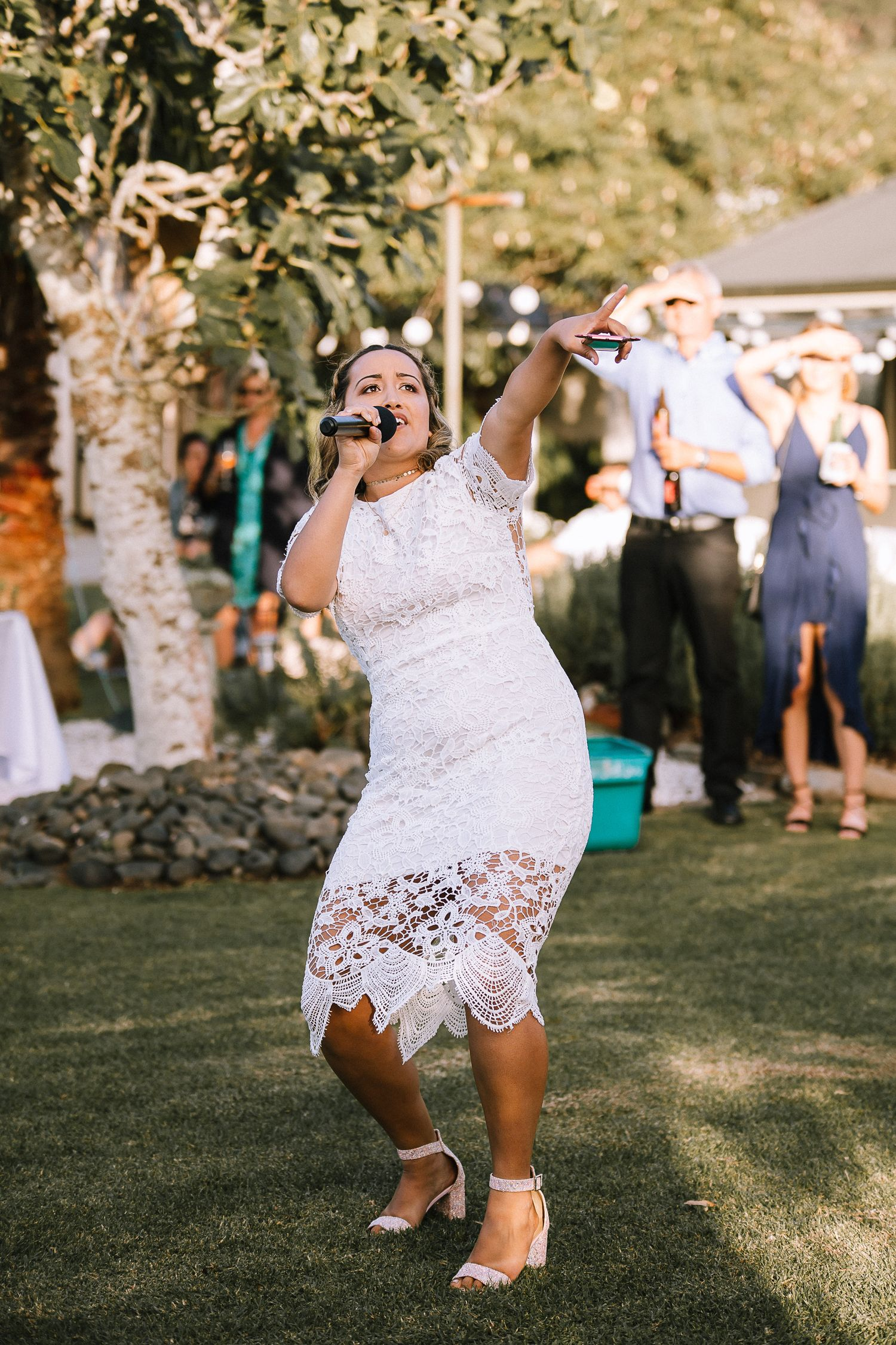 Bridesmaid singing at wedding in Coromandel