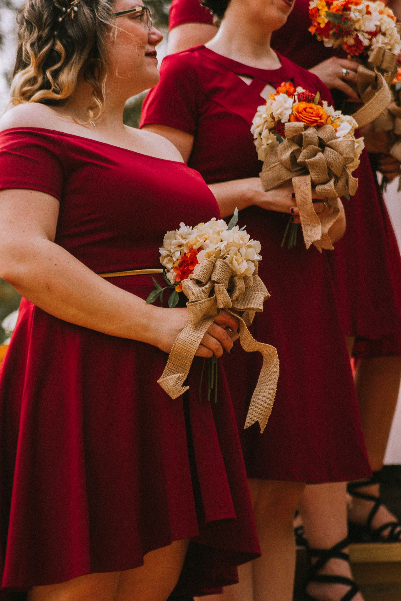 bridesmaids at an intimate wedding holding bouquets