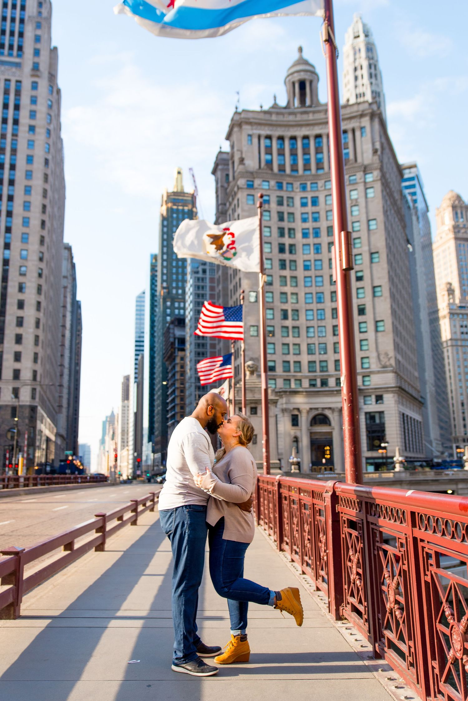 man and woman kissing on Dusable Bridge for Chicago engagement photos