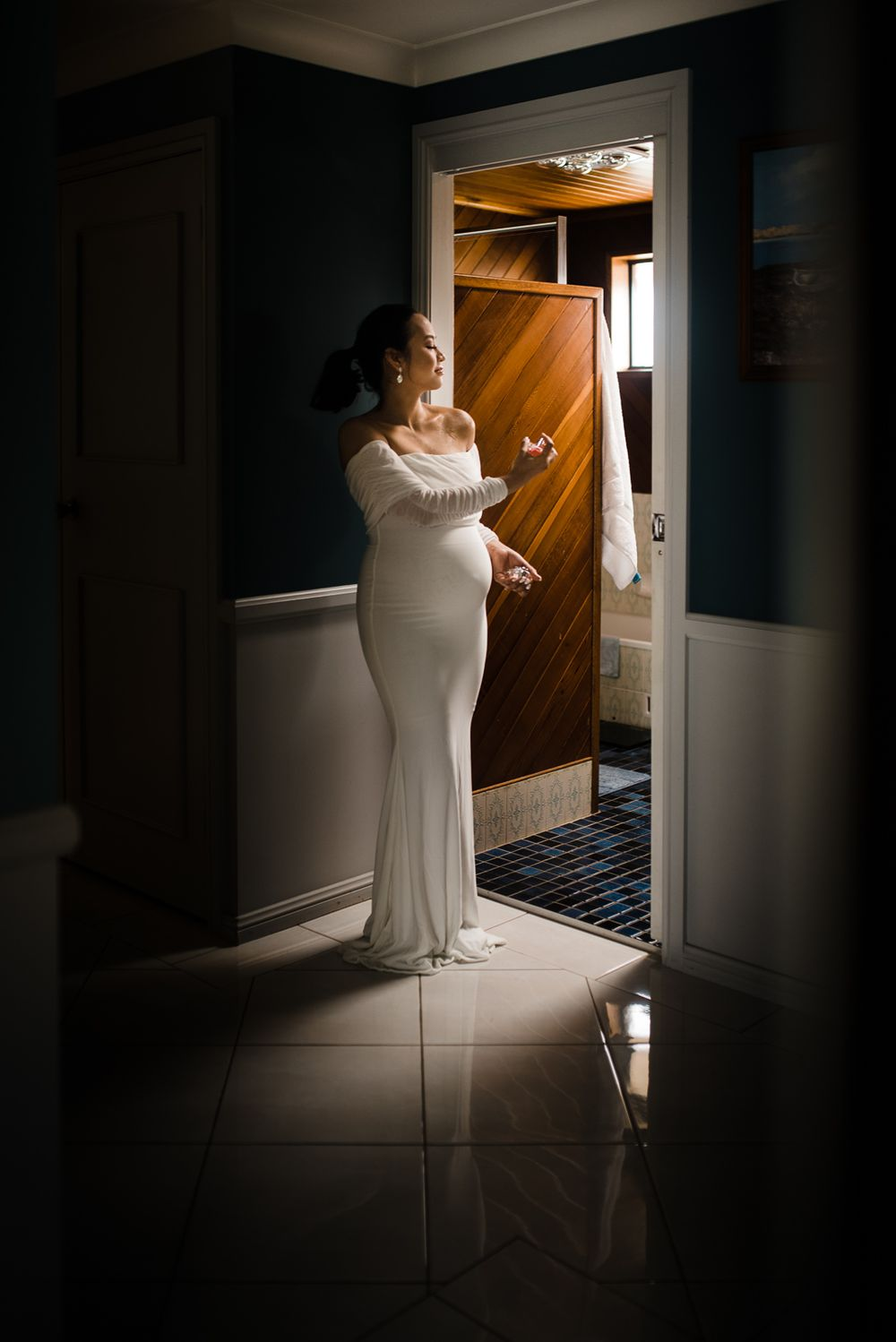 bride putting final touch to her wedding dress