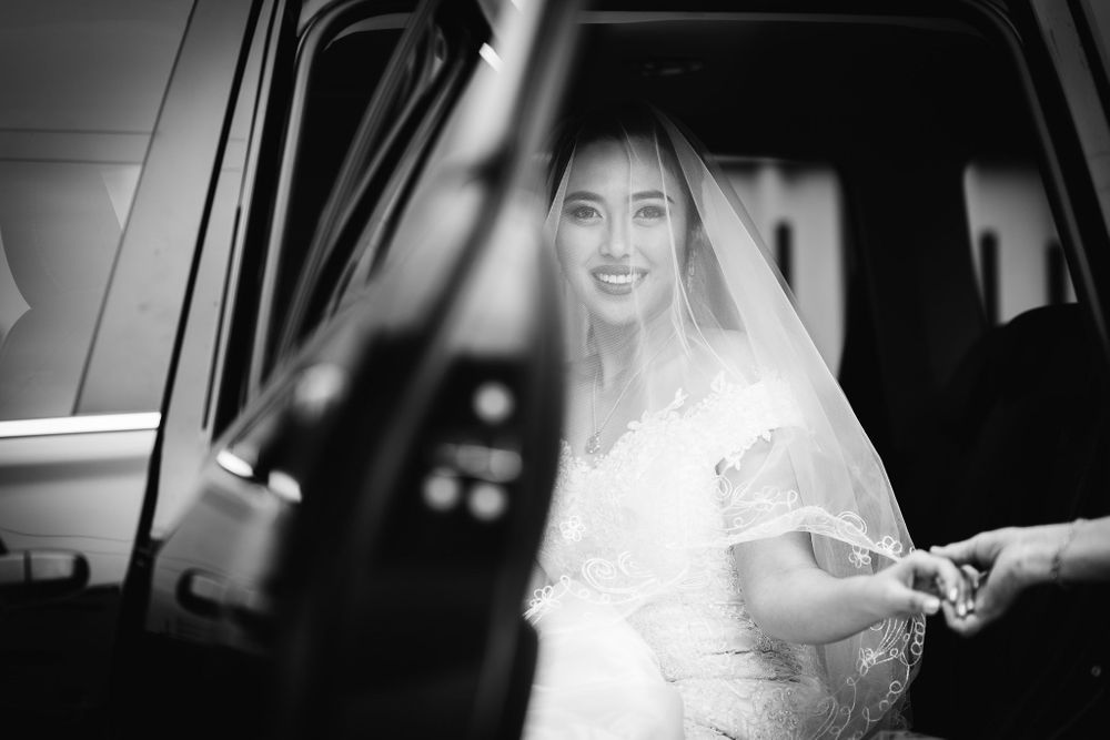 bride stepping out of her wedding car