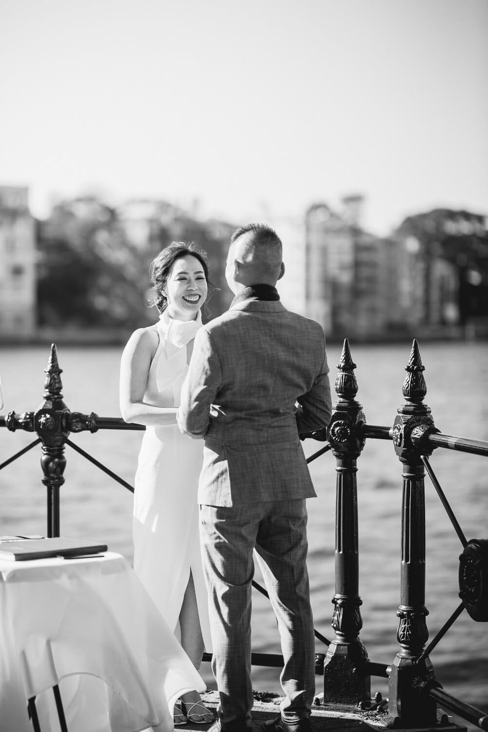 a smiling bride during wedding ceremony at Sydney Harbour