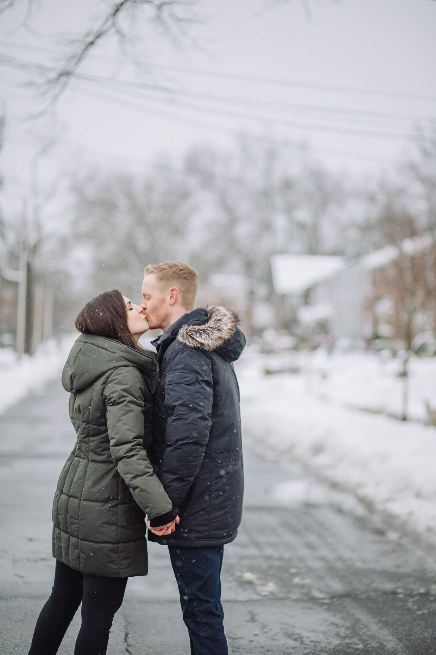 Couple kissing in the snow with engagement photographer in Collingswood, NJ.