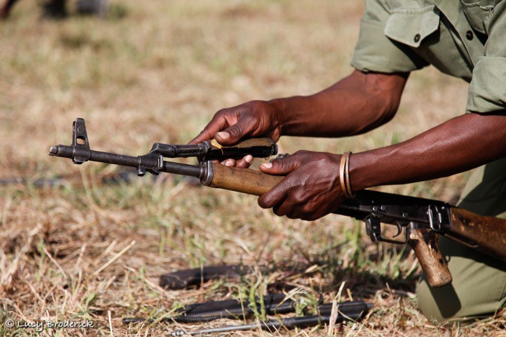 A National Parks Ranger strips and cleans his weapon during an anti poaching course, Mkanga, Dande, Zimbabwe.