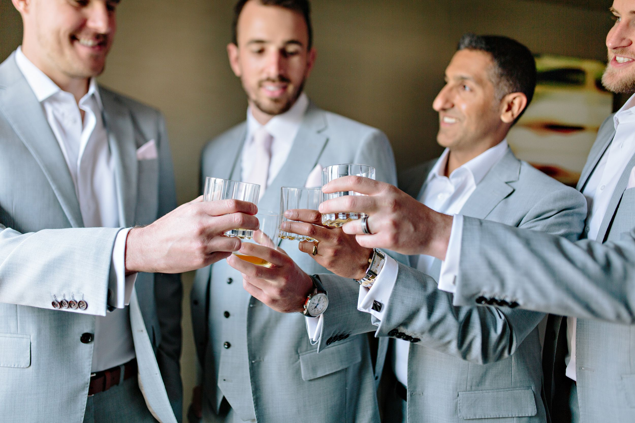 groomsmen clinking glasses