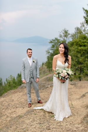 bride holding wedding bouquet with groom