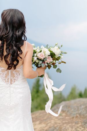 bridal bouquet with ribbon blowing in wind