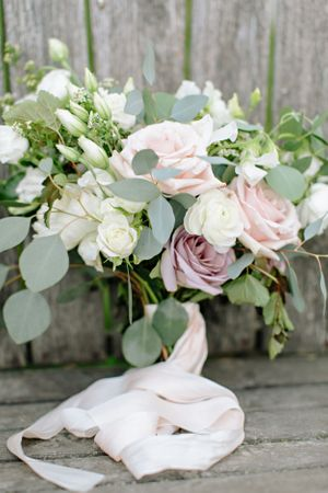 bridal bouquet resting on wooden chair