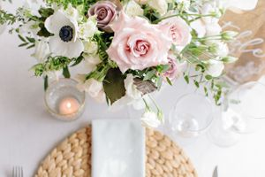 wedding reception table florals and place setting