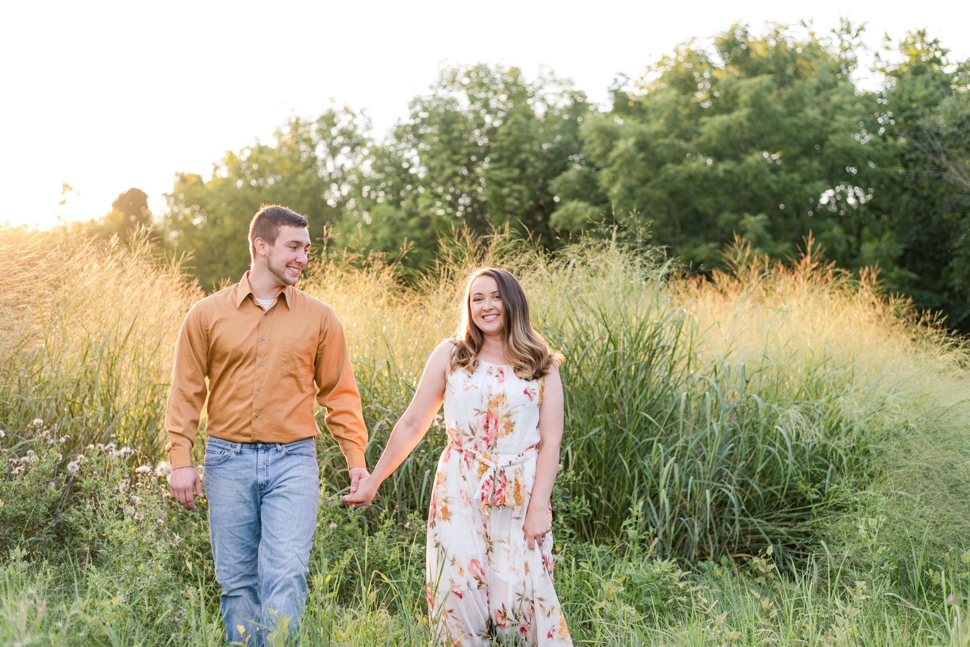 Engagement in tall grass at Moraine State Park in Pennsylvania