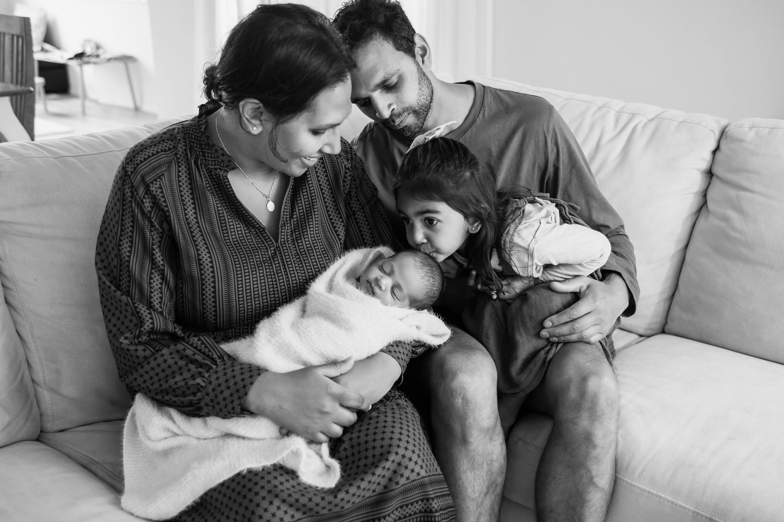 Family and newborn baby in home shoot auckland
