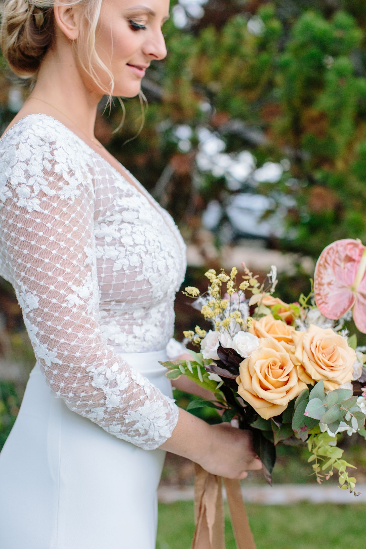 lace wedding dress and fall colour boquet