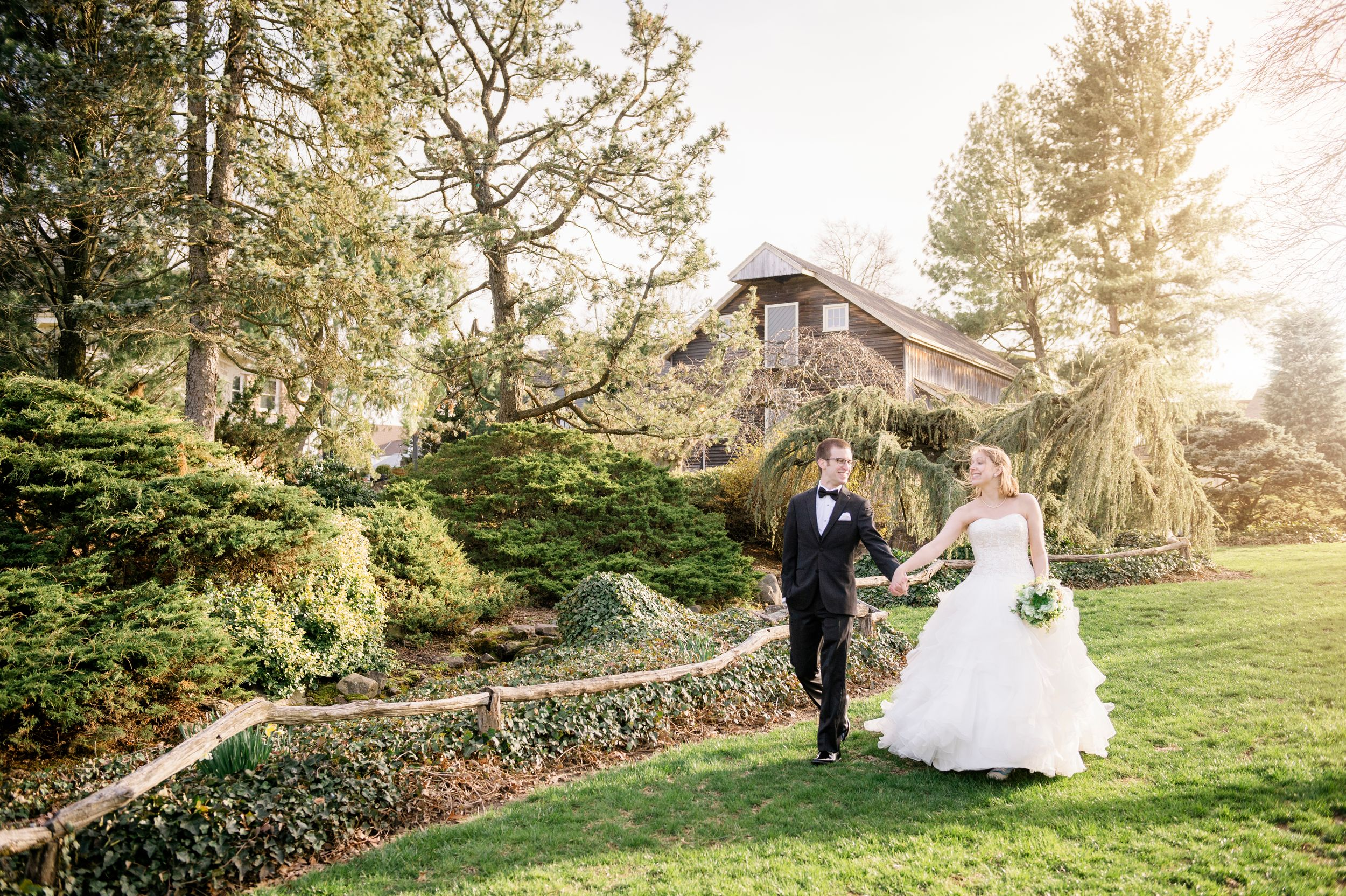 sunset wedding photo of bride and groom walking at peddlers village wedding venue