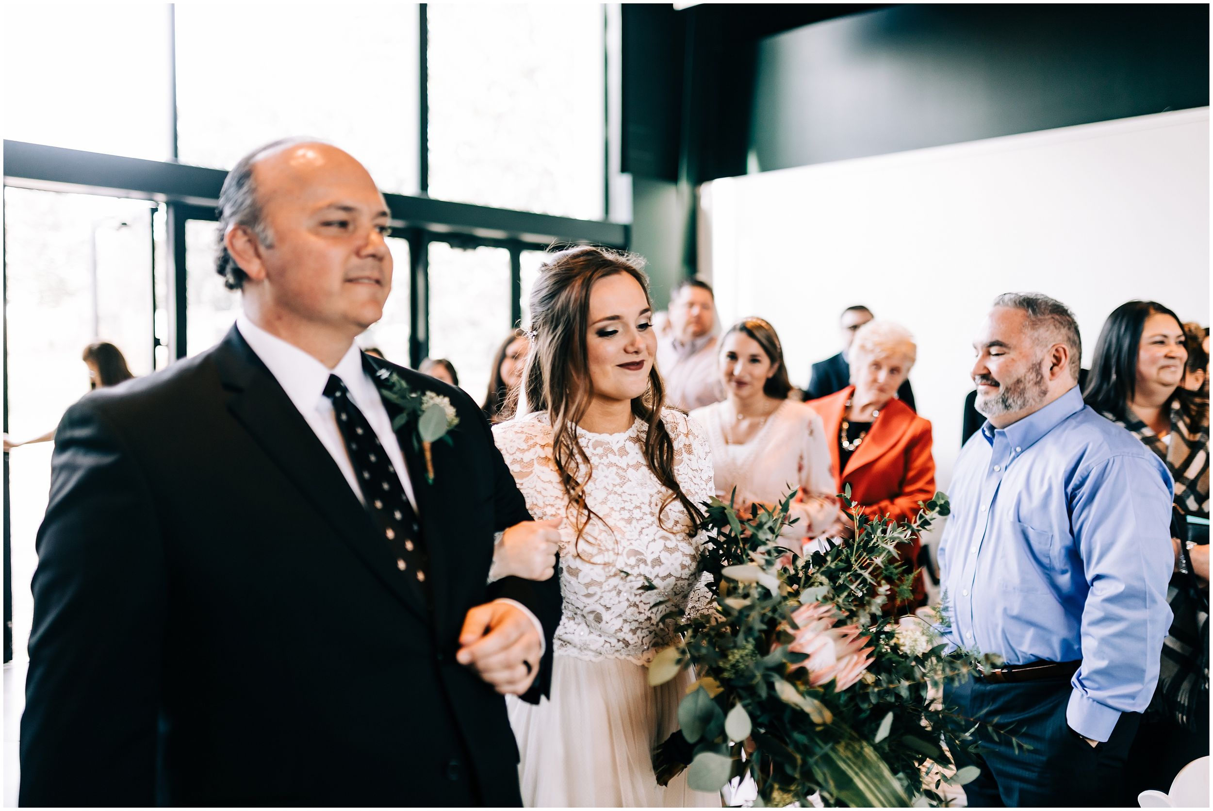 bride walking down aisle with dad