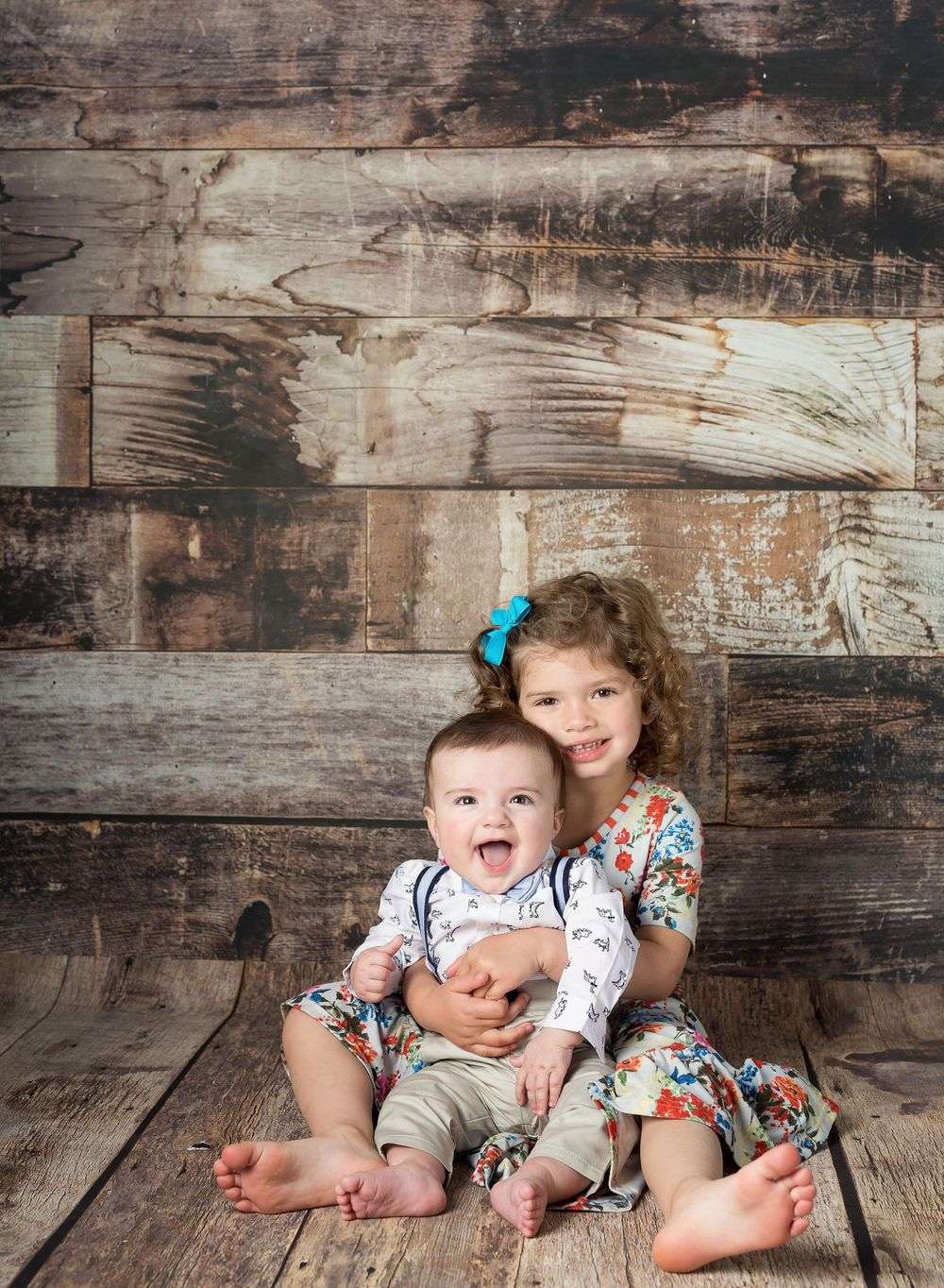 austin newborn photography milestone session sitter baby with big sister wood background