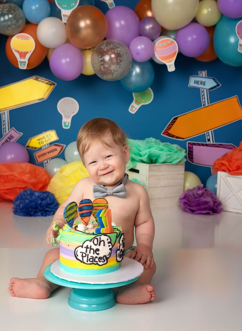 austin newborn photography cake smash Oh the places you'll go balloon garland one year session