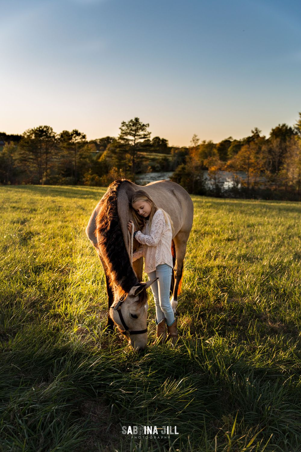 Girl leaning on her horse in Waxhaw, NC field