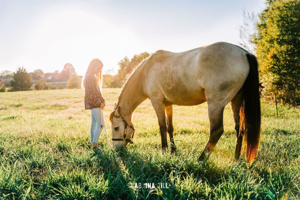 Girl standing in front of her horse in Waxhaw, NC