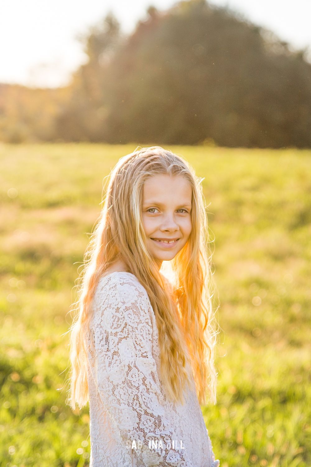 Girl outside at sunset in a Waxhaw NC field