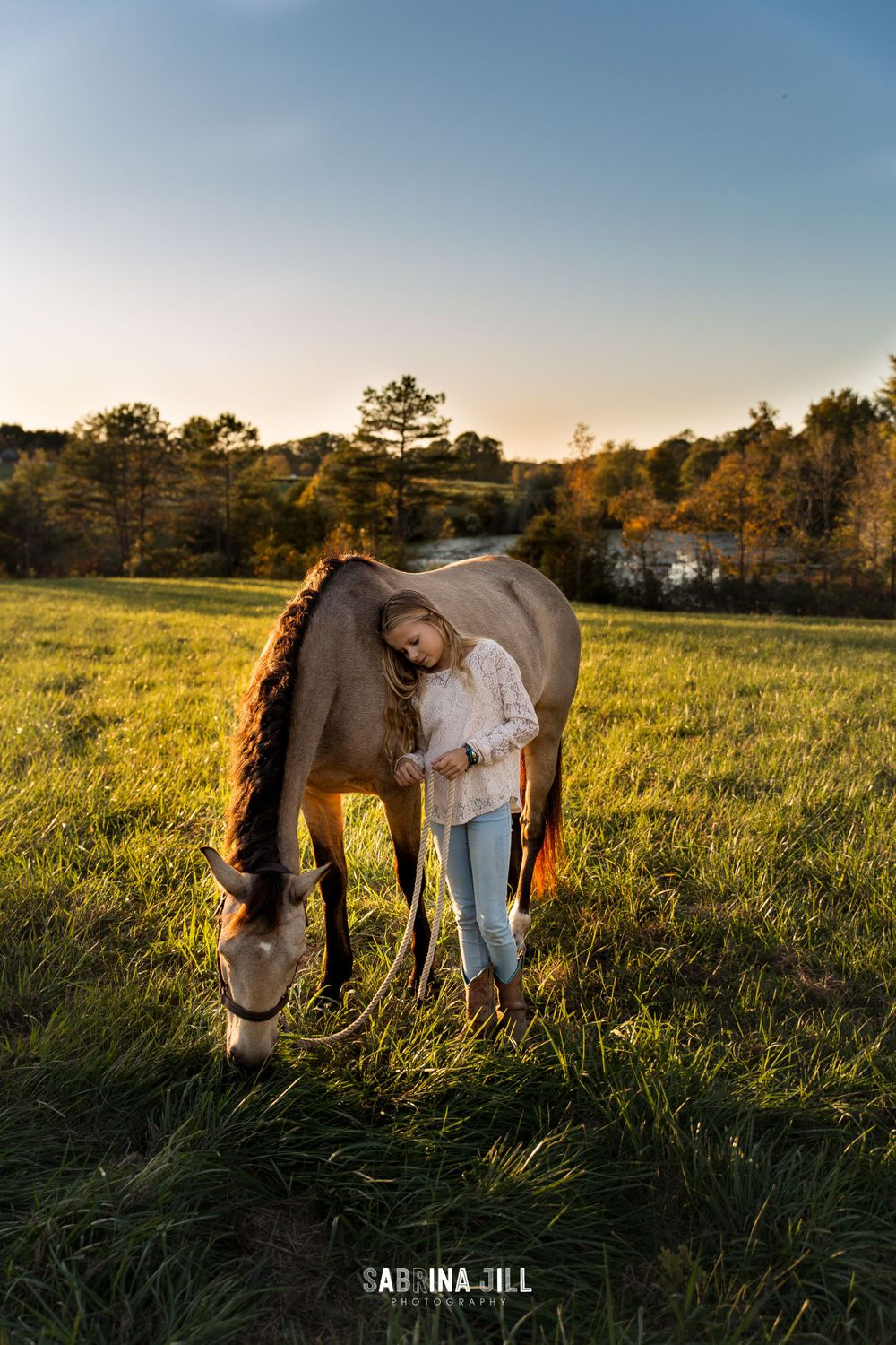 Girl leaning on her horse in a Waxhaw, NC field