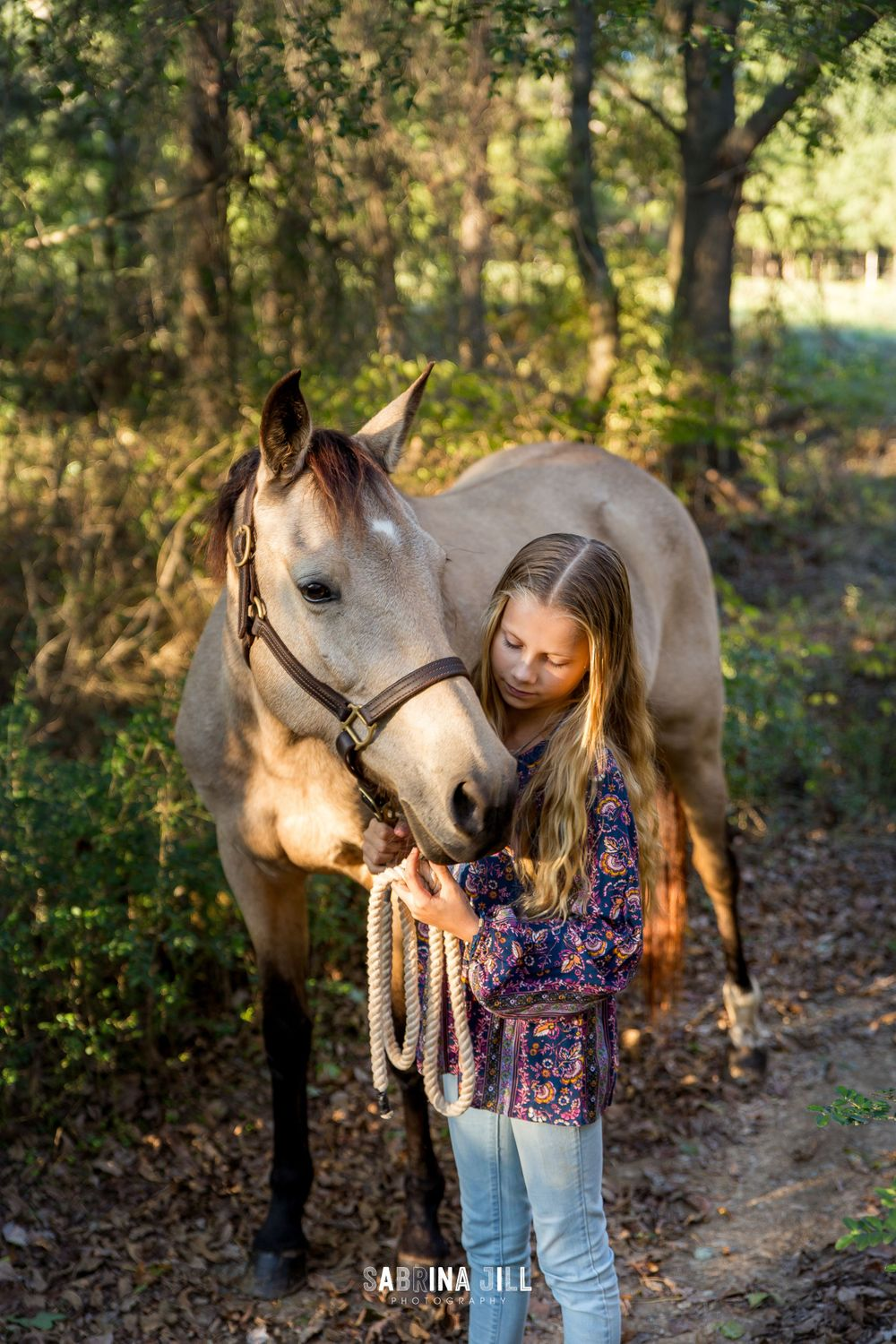 Girl looking at her horse