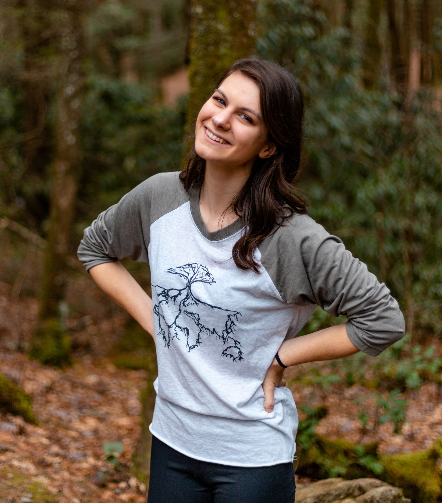 Sarah Swainson wearing Burlaep clothing in the forest.