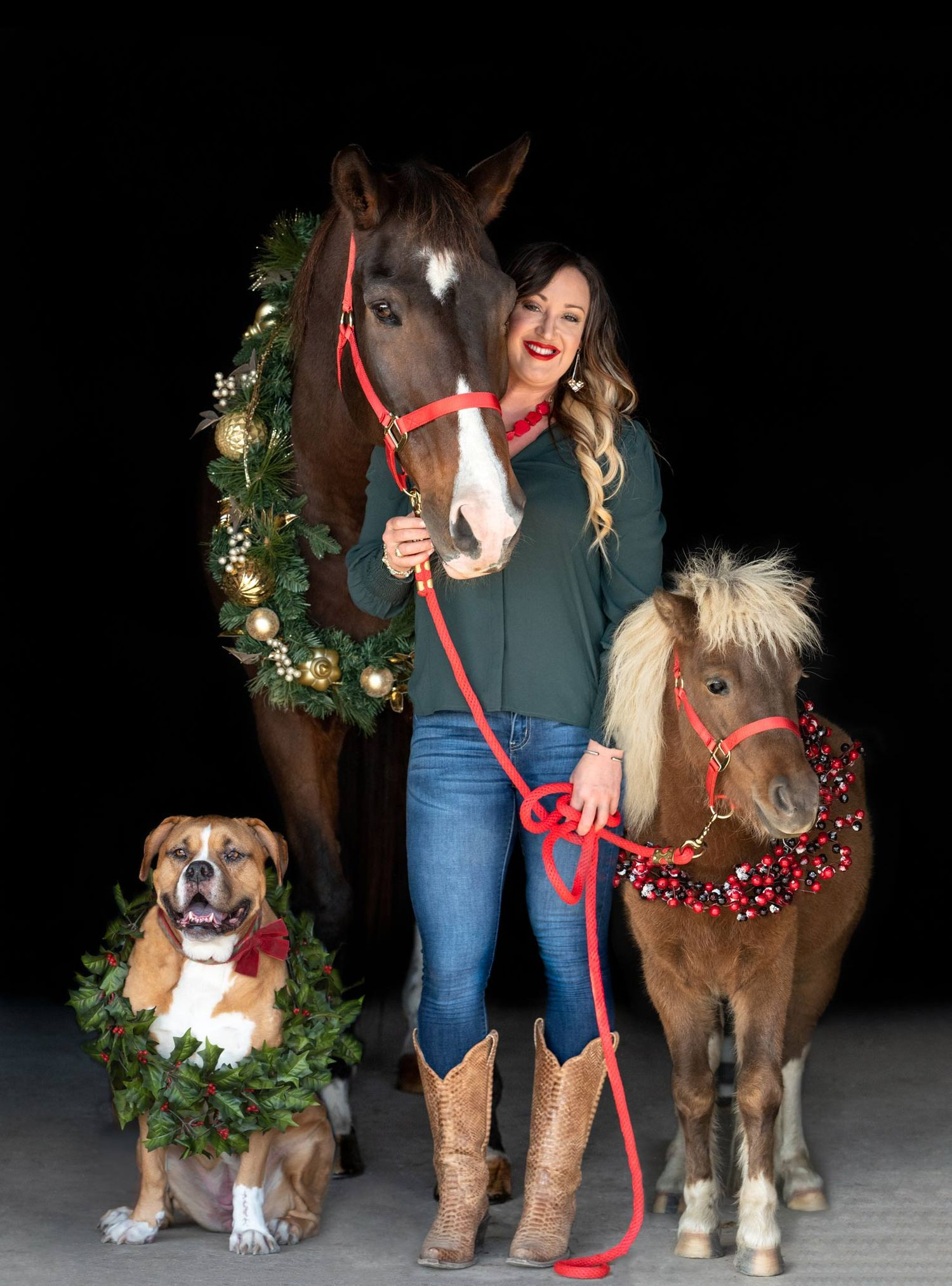 Woman posting with horse and pony and dog