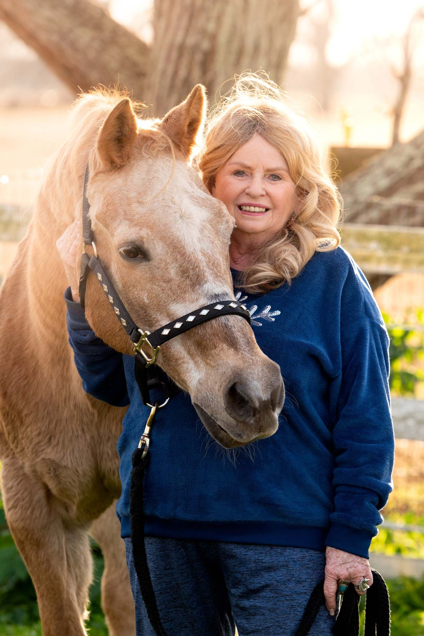 Woman smiling with palomino horse texas