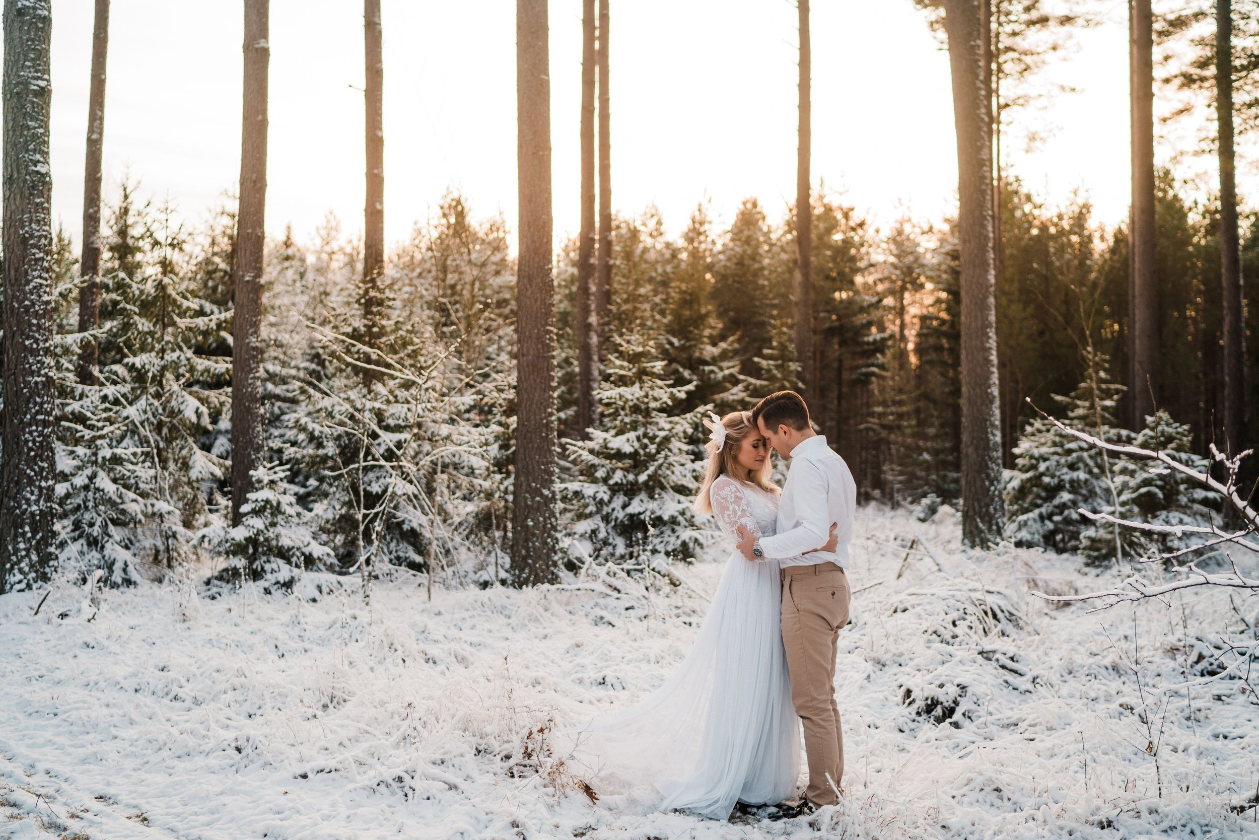 swedish adventure elopement photographer maria karlsson wild love by maria couple hugging in snow