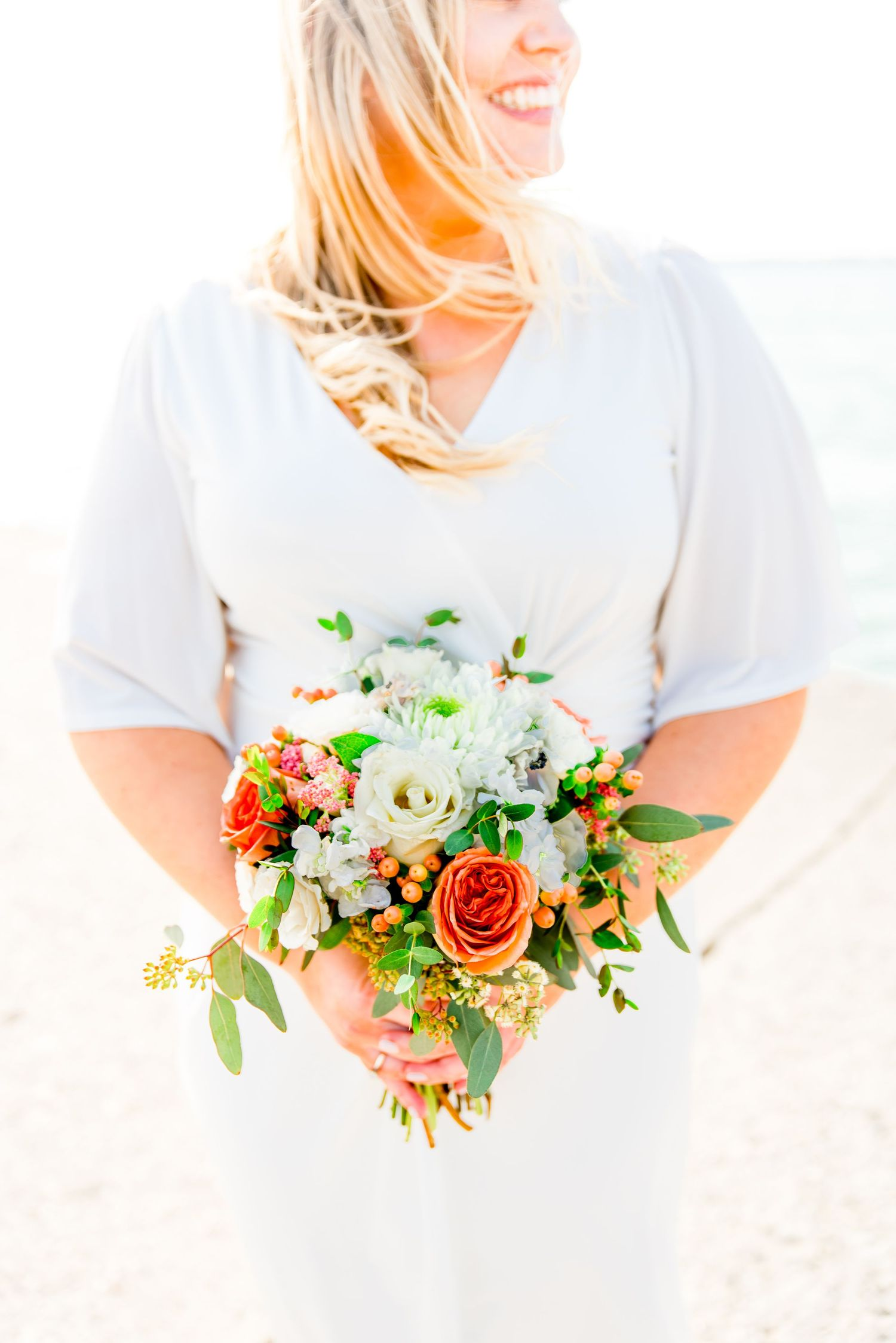 orange and white chicago elopement bouquet for north avenue beach sunrise elopement