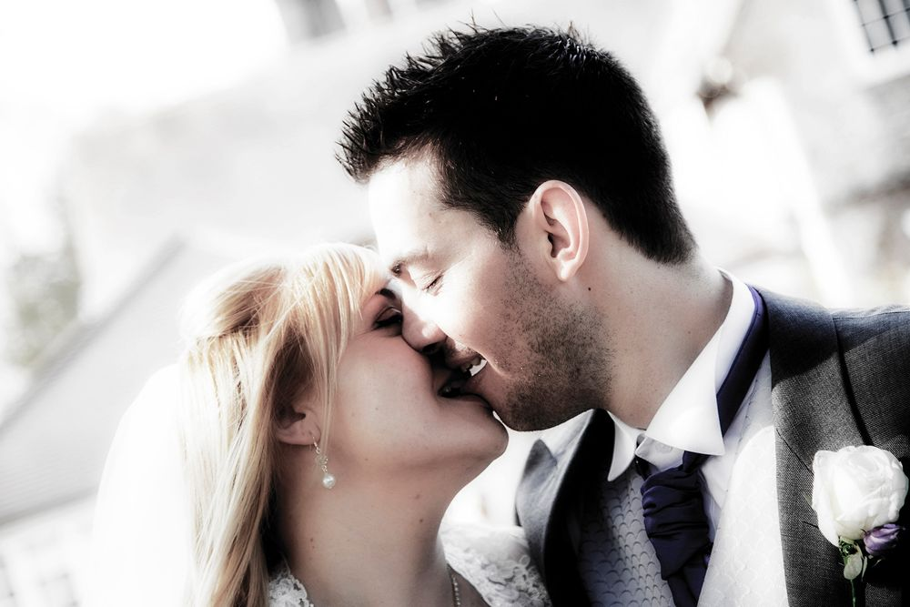 close up of bride and groom kissing