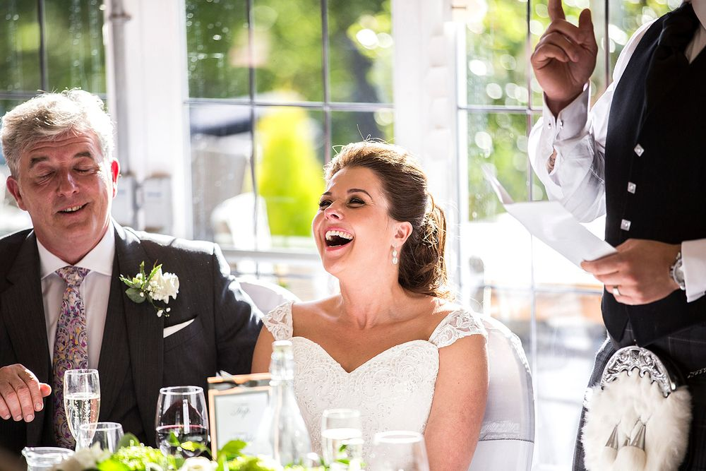 bride laughing at bestmans speech