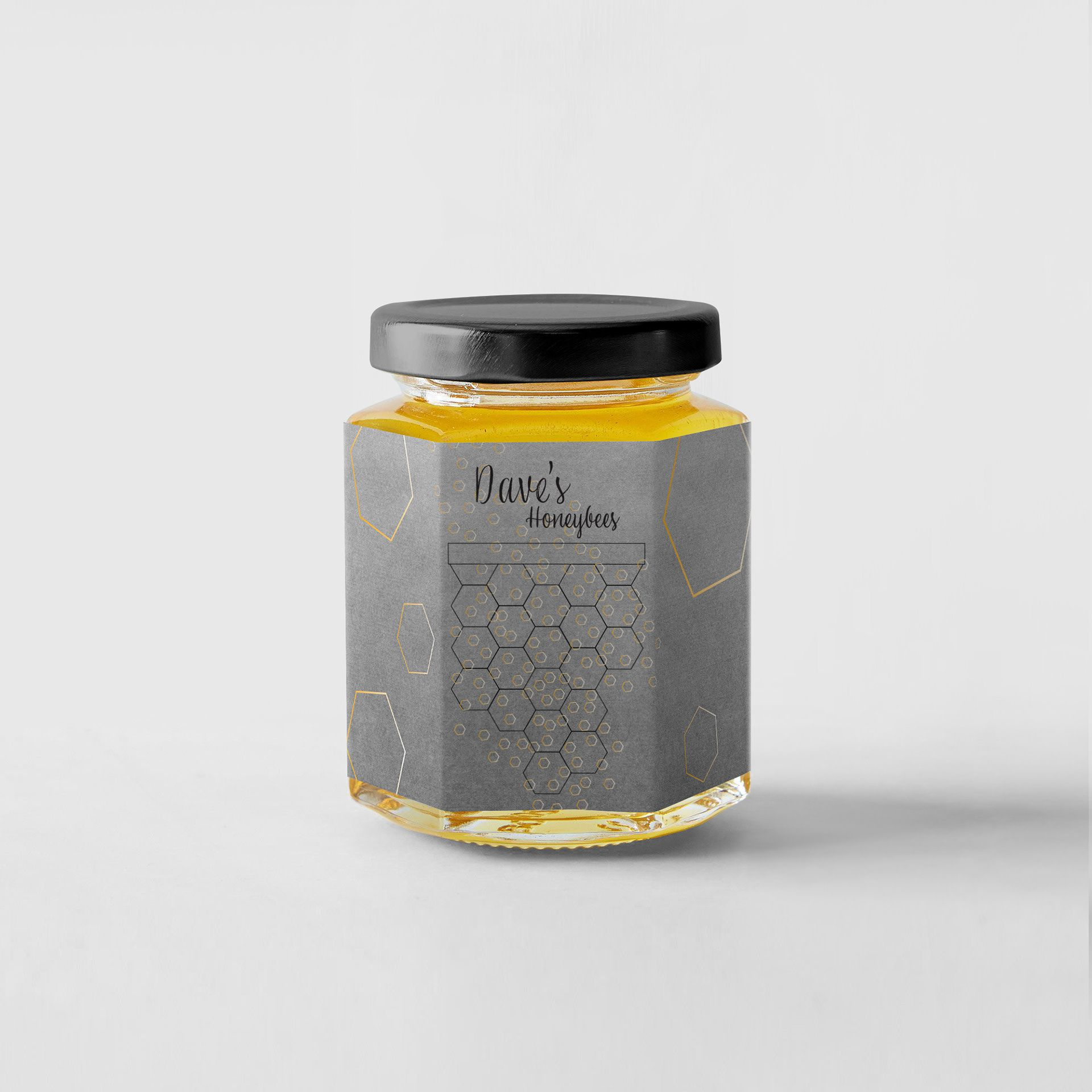 Designed jar of bee honey with honeycombs labeled Dave's Honeybees.