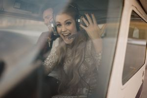 bride-excited-flying-air-plane-ankeny-iowa-raelyn-ramey-photography