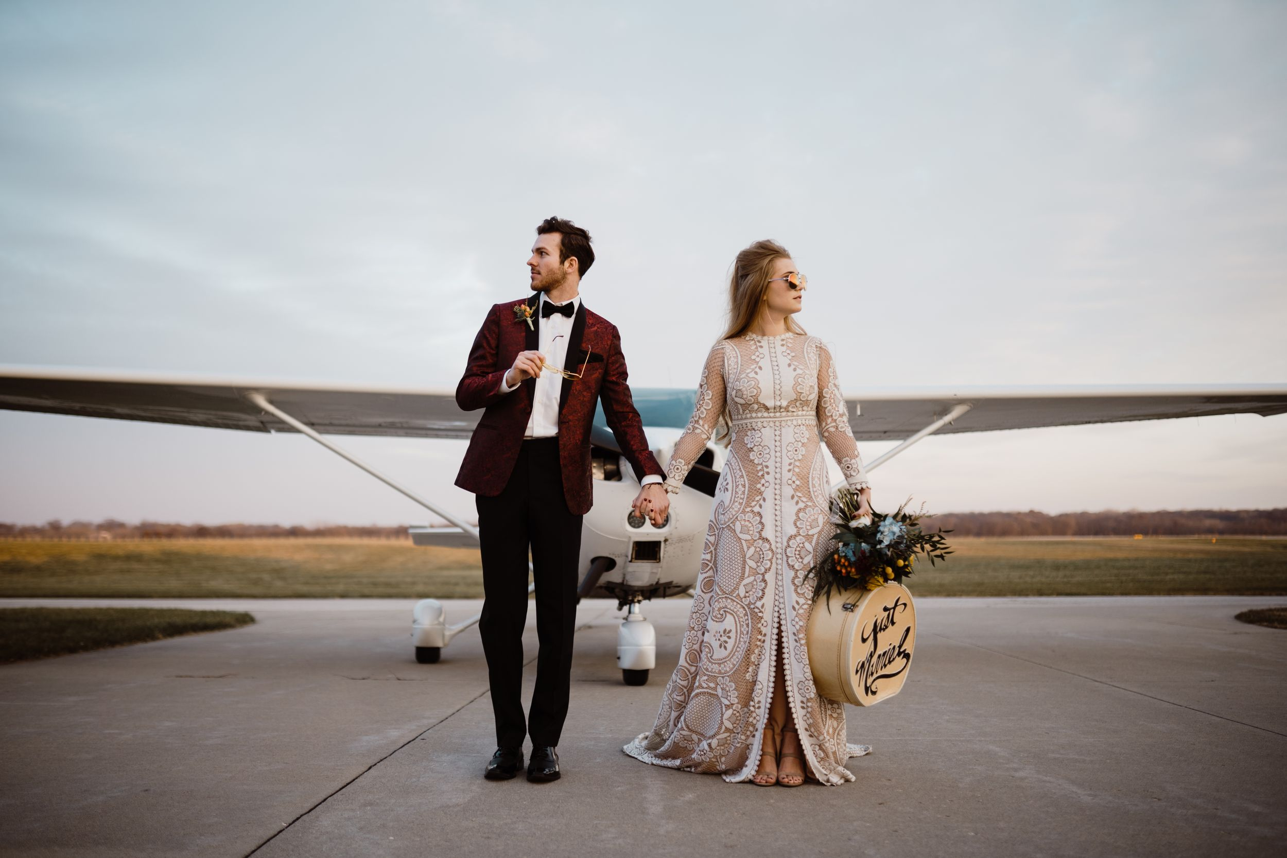bride-groom-standing-in-front-of-plane-ankeny-iowa-raelyn-ramey-photography