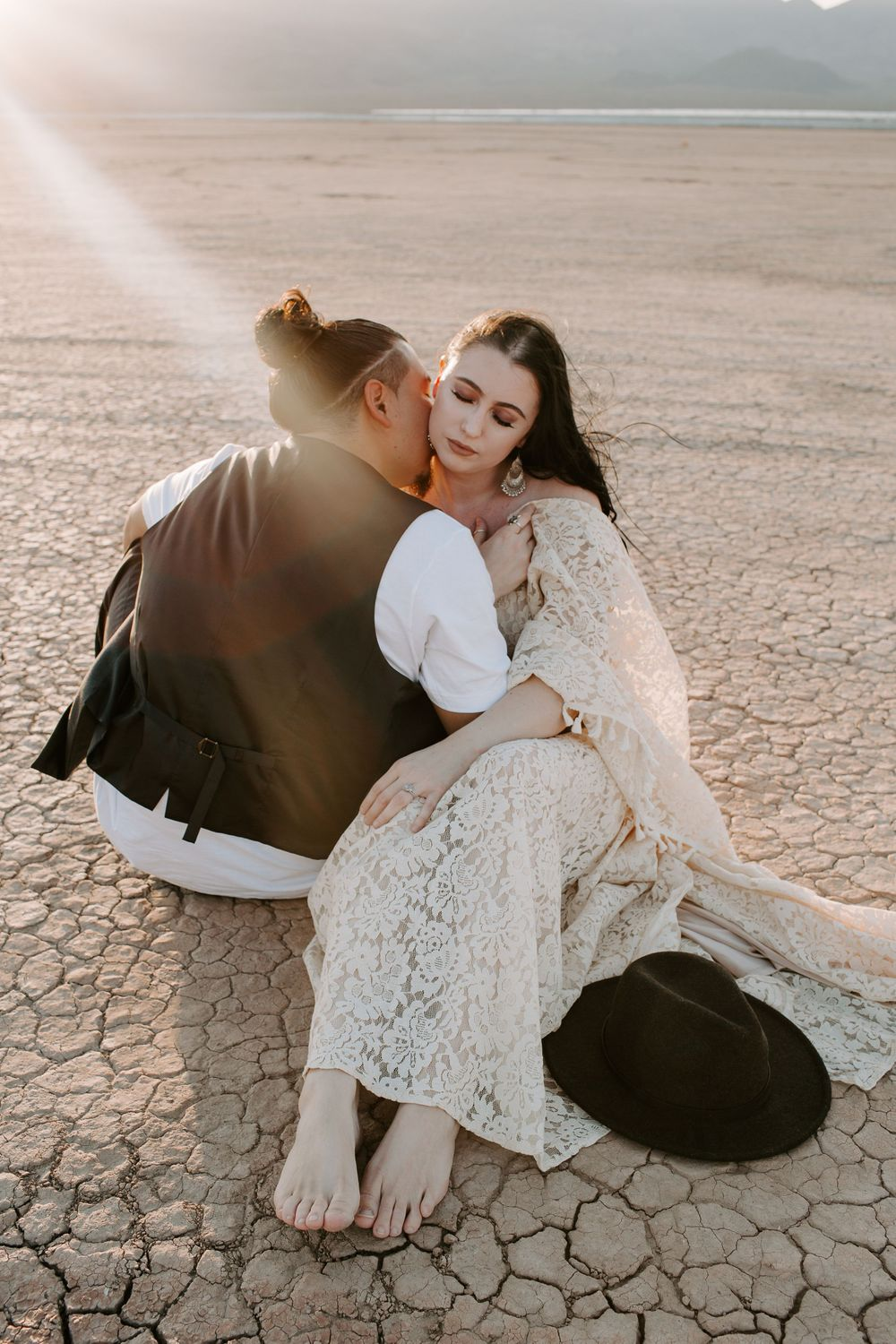 couple sitting on a dry lake bed in Las Vegas