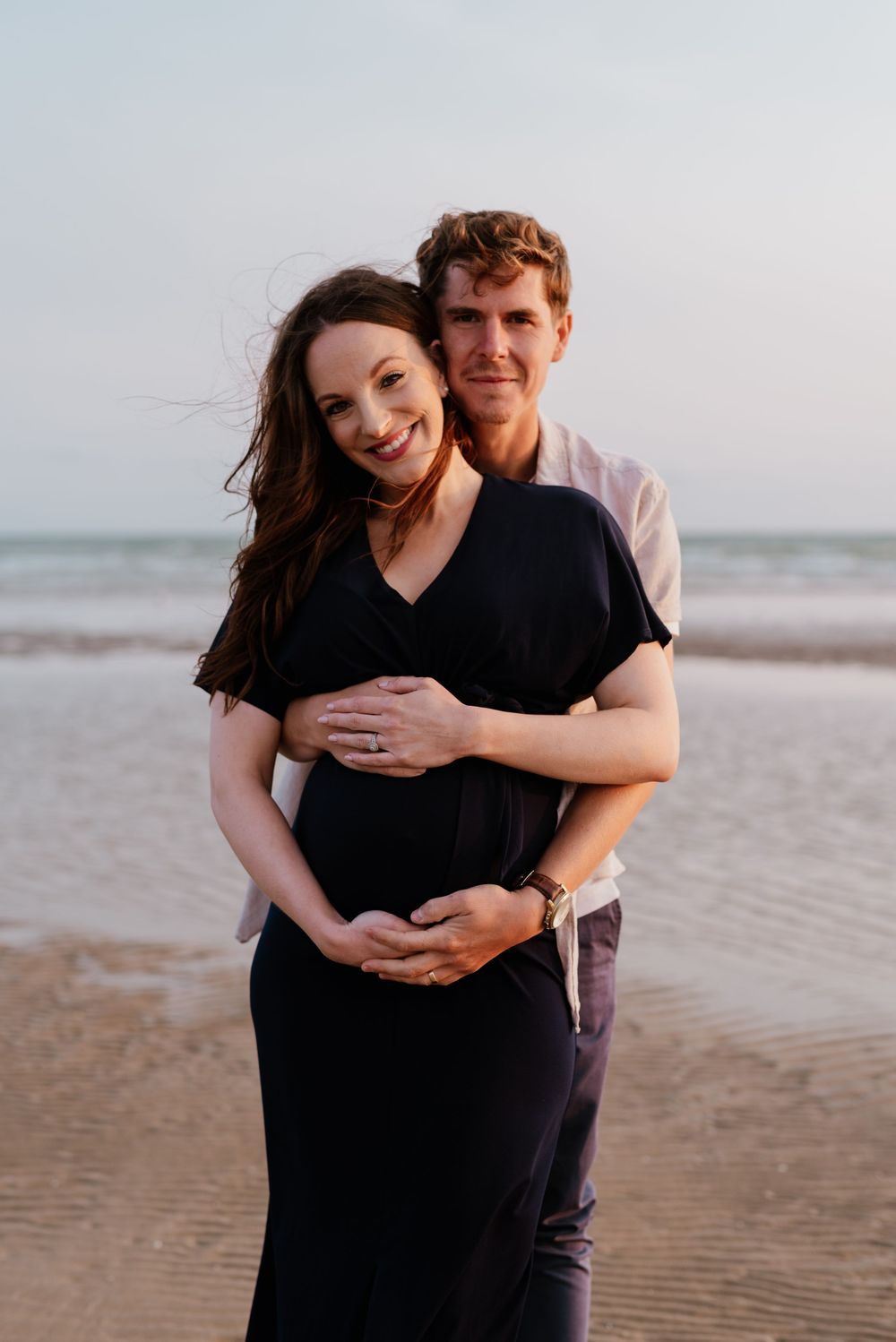 Beach maternity couple portrait at Camber Sands