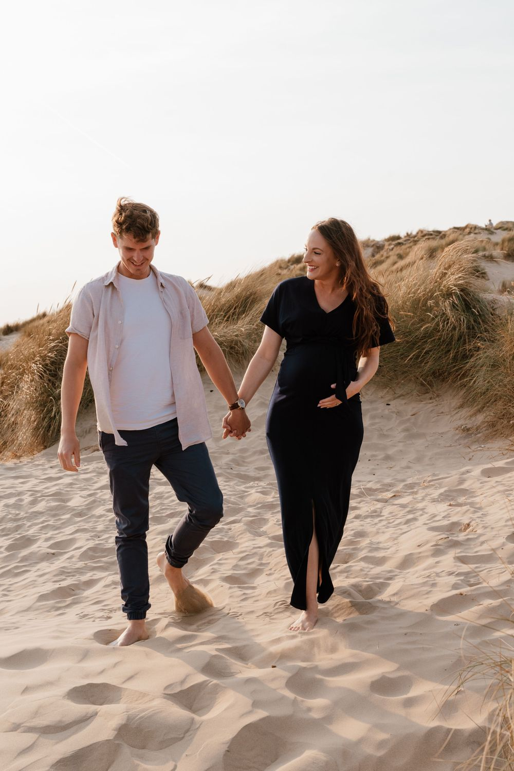 Sandy beach couple portrait session