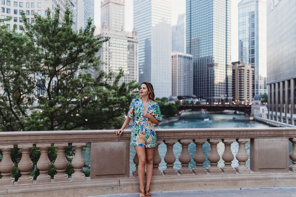 Woman standing by Riverwalk downtown Chicago portraits lifestyle session