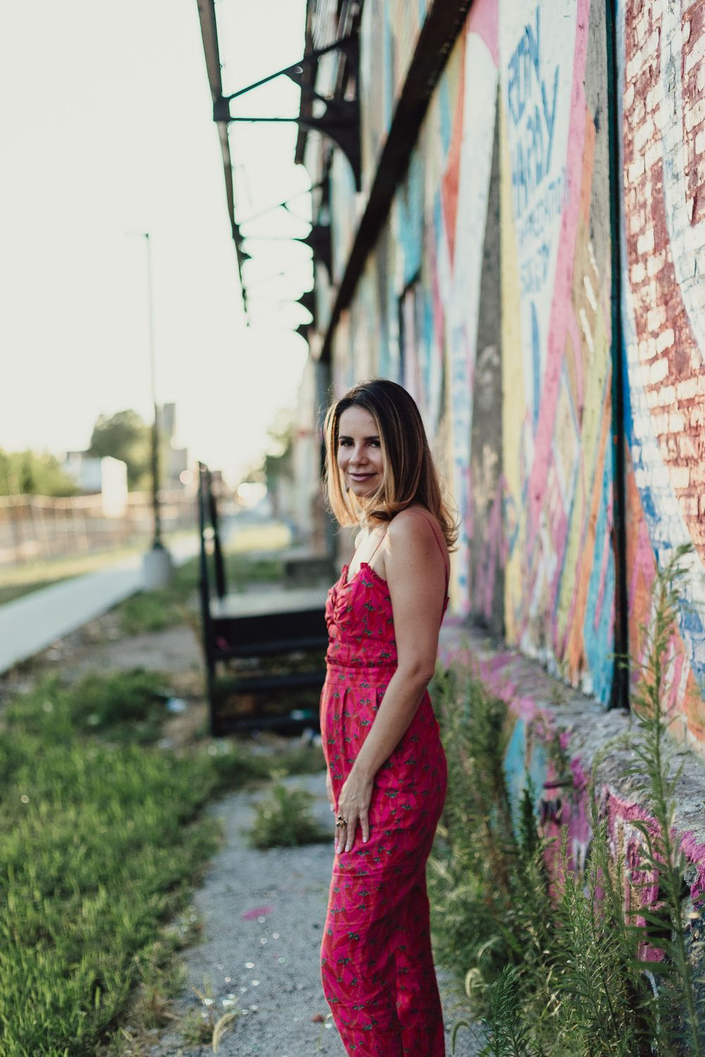Woman standing by train tracks West Loop Chicago portraits lifestyle session